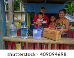 Small photo of Chone, Ecuador - April, 18, 2016: Family receiving aid in food medicine and water after 7.8 earthquake that destroyed their house and most of the Manabi province