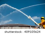 Firefighters Spray Water To...