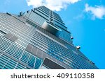 Small photo of Taipei / Taiwan - February 22, 2014: Business concept for real estate and corporate construction:Looking up view of Taipei 101, the landmark of Taiwan, reflect blue sky and sun lights