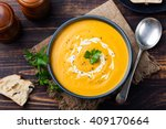pumpkin and carrot soup with... | Shutterstock . vector #409170664