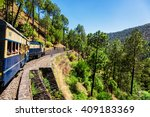 Small photo of HIMACHAL PRADESH, INDIA - MAY 12, 2010: Toy train of Kalka-Shimla Railway - narrow gauge railway built in 1898 and famous for its scenery and improbable construction. It is UNESCO World Heritage Site