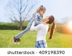 beautiful young mother with her ... | Shutterstock . vector #409198390