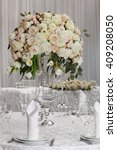 table setting at a luxury... | Shutterstock . vector #409208050