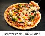 Vegetarian Pizza On A Dark...