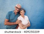 portrait of smiling mature... | Shutterstock . vector #409250209