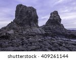 Two Huge Rocks Tower Above The...