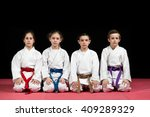 children in kimono sitting on... | Shutterstock . vector #409289329