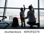 mother and son pointing at... | Shutterstock . vector #409293274
