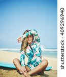 beautiful young surfer girl on... | Shutterstock . vector #409296940