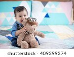 cute 11 month old mixed race... | Shutterstock . vector #409299274