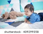cute 11 month old mixed race... | Shutterstock . vector #409299358