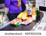 young woman putting goods on... | Shutterstock . vector #409302436