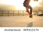 skateboarding woman at sunrise... | Shutterstock . vector #409312174