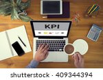 kpi concept laptop and coffee... | Shutterstock . vector #409344394