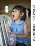asian girls are having drinks   Shutterstock . vector #409390609