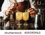 Stock photo barman is decorating cocktail with lemon no face 409390963