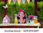 yang girl at the lemonade stand | Shutterstock . vector #409394389
