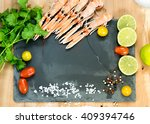 raw scampis on ice with herbs... | Shutterstock . vector #409394746
