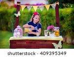 young girl at the lemonade stand | Shutterstock . vector #409395349