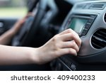 woman turning button of radio... | Shutterstock . vector #409400233