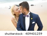 groom and bride posing on the... | Shutterstock . vector #409401259