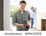 young couple renovating... | Shutterstock . vector #409415593