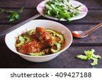 a bowl of chicken noodle soup... | Shutterstock . vector #409427188