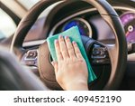 hand with microfiber cloth... | Shutterstock . vector #409452190