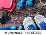 sport stuff on wooden table ...   Shutterstock . vector #409521970