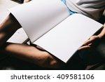 cute little boy reading book  | Shutterstock . vector #409581106