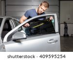 applying tinting foil onto a... | Shutterstock . vector #409595254