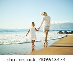 happy mother and young daughter ... | Shutterstock . vector #409618474