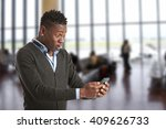 excited man looking at his... | Shutterstock . vector #409626733