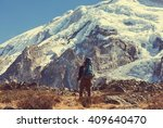 hiker in himalayas mountain.... | Shutterstock . vector #409640470