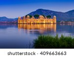 the palace jal mahal at night.... | Shutterstock . vector #409663663