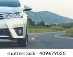 Stock photo close up front of new silver car parking on the asphalt road 409679020
