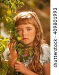 little girl in garden | Shutterstock . vector #409801993