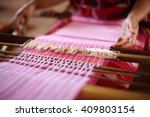 Unidentified Women Weaving...