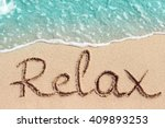 Word Relax Handwritten On Sandy ...