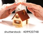 house and wedding rings ...   Shutterstock . vector #409920748