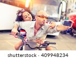 couple of bikers taking selfie... | Shutterstock . vector #409948234