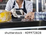 saleswoman accepting payment... | Shutterstock . vector #409972828