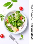 healthy spinach salad with a... | Shutterstock . vector #409989448