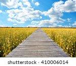wooden bridge on summer meadow... | Shutterstock . vector #410006014