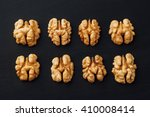 shelled walnuts in a row on... | Shutterstock . vector #410008414