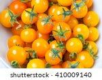Yellow Cherry Tomato On White...