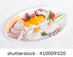 scrambled eggs with ham  cheese ... | Shutterstock . vector #410009320