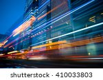 light trails in the downtown... | Shutterstock . vector #410033803