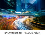 light trails in the downtown... | Shutterstock . vector #410037034