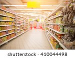 supermarket aisle and shelves... | Shutterstock . vector #410044498